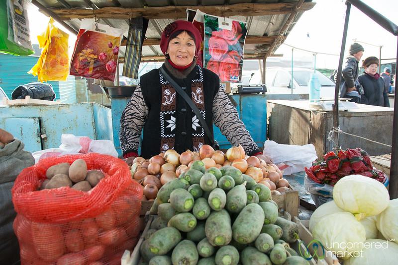Friendly Kyrgyz Vegetable Vendor at Big Bazaar - Karakol, Kyrgyzstan