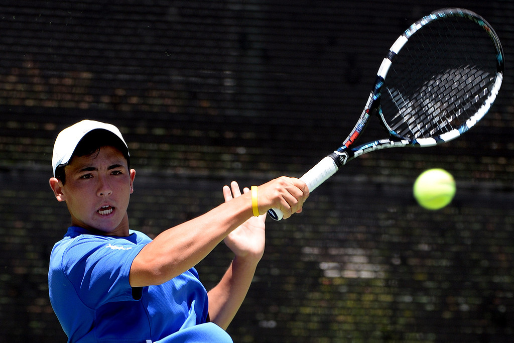. San Marino\'s Daniel Gealer returns a shot by University\'s (Irvine) Drew Dawson (not pictured) during the CIF State Tennis Championship at the Claremont Club in Claremont, Calif., on Saturday, May 31, 2014. Gealer won 7-6, 6-1.   (Keith Birmingham/Pasadena Star-News)