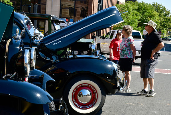 9/21/2019 Mike Orazzi | StaffrMembers of the Vasil family, Kenny, Rosemary and Bob check out vehicles during the New Britain Downtown District's 13th annual car show on Saturday.