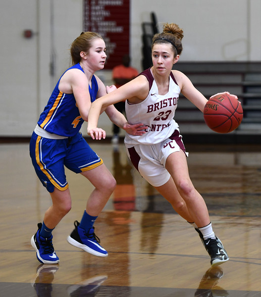 12/31/2019 MIke Orazzi   Staff Bristol Central's Ella Watson (23) and Gilbert's Kim McCarthy (4) during Tuesday's girls basketball game in Bristol.