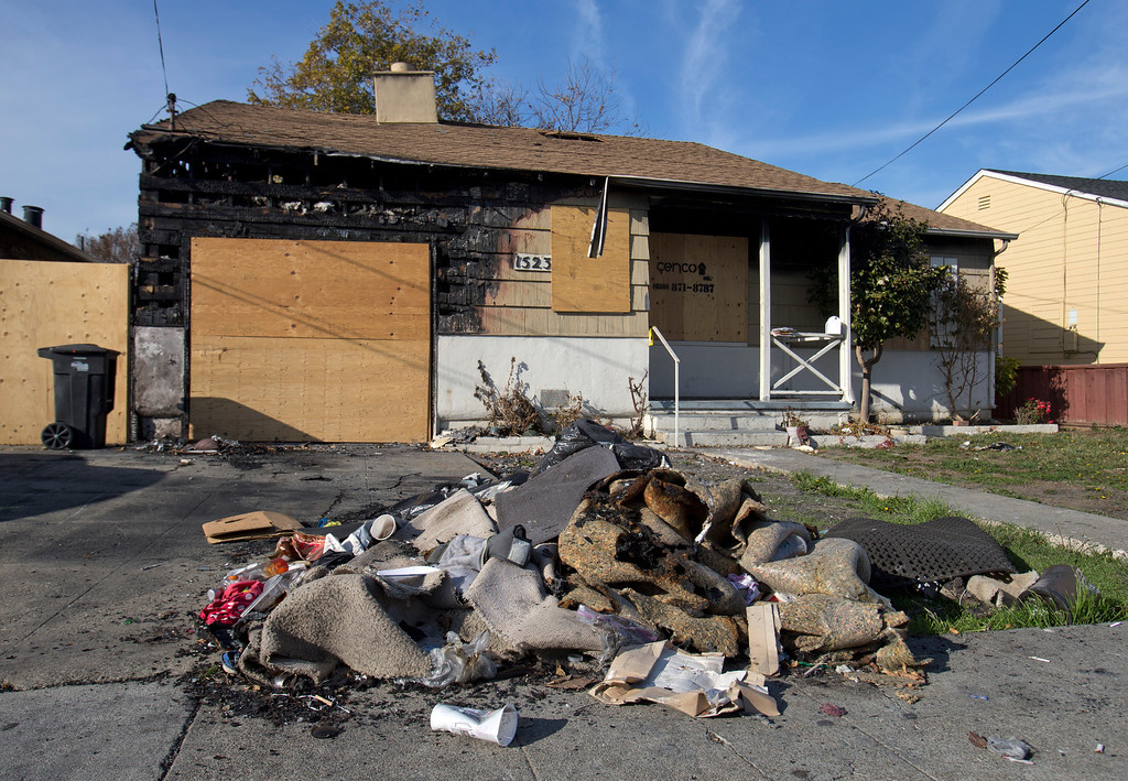 . Uatesoni Paasi and Anna Paasi\'s house that was destroyed by a fire in Decemeber, in San Mateo, Calif. on Thursday, Jan. 2, 2014.  (LiPo Ching/Bay Area News Group)