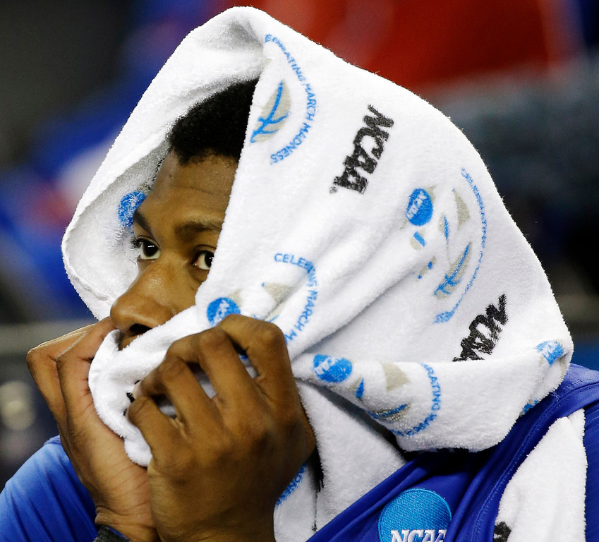 . Florida Gulf Coast\'s Eric McKnight (12) reacts during the final minutes of a regional semifinal game against Florida in the NCAA college basketball tournament, Saturday, March 30, 2013, in Arlington, Texas. (AP Photo/David J. Phillip)