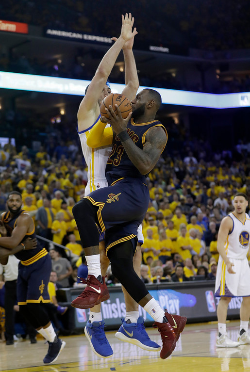 . Cleveland Cavaliers forward LeBron James (23) shoots against Golden State Warriors center Zaza Pachulia, rear, during the second half of Game 1 of basketball\'s NBA Finals in Oakland, Calif., Thursday, June 1, 2017. (AP Photo/Marcio Jose Sanchez)