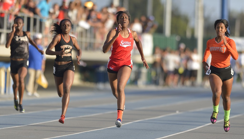. NORWALK, CALIF. USA -- Serra\'s Chimere Ezumah competes in the 400 meter dash during the CIF-SS Masters Track and Field Meet in Norwalk, Calif., on Friday, May 24, 2013. Photo by Jeff Gritchen / Los Angeles Newspaper Group