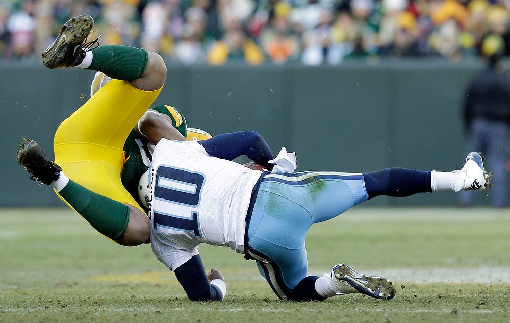 . Green Bay Packers\' Mike Neal sacks Tennessee Titans quarterback Jake Locker (10) during the second half of an NFL football game Sunday, Dec. 23, 2012, in Green Bay, Wis. (AP Photo/Jeffrey Phelps)