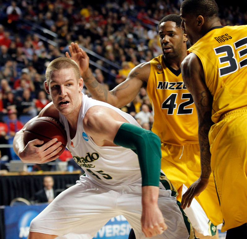 . Colorado State University\'s Colton Iverson (L) battles for the rebound with Missouri University\'s Earnest Ross (R) during the first half in their second round NCAA basketball game at Rupp Arena in Lexington, Kentucky March 21, 2013.    REUTERS/ John Sommers II