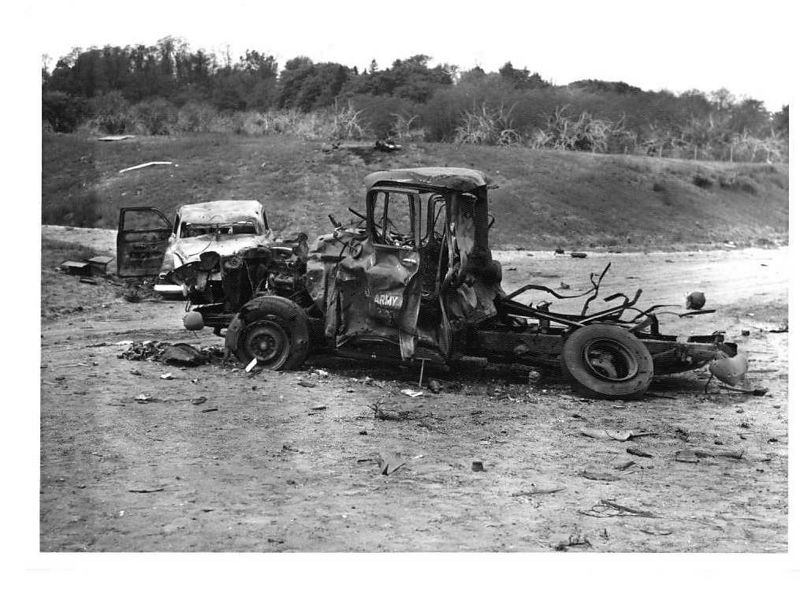 Remains of Government truck and civilian vehicle (Studebaker)  .22 May 1958