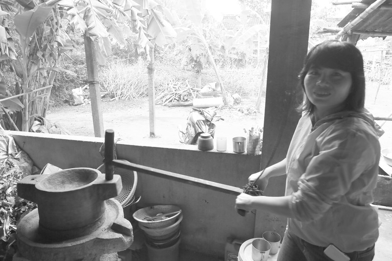Grinding Rice the old fashioned way - Sue.