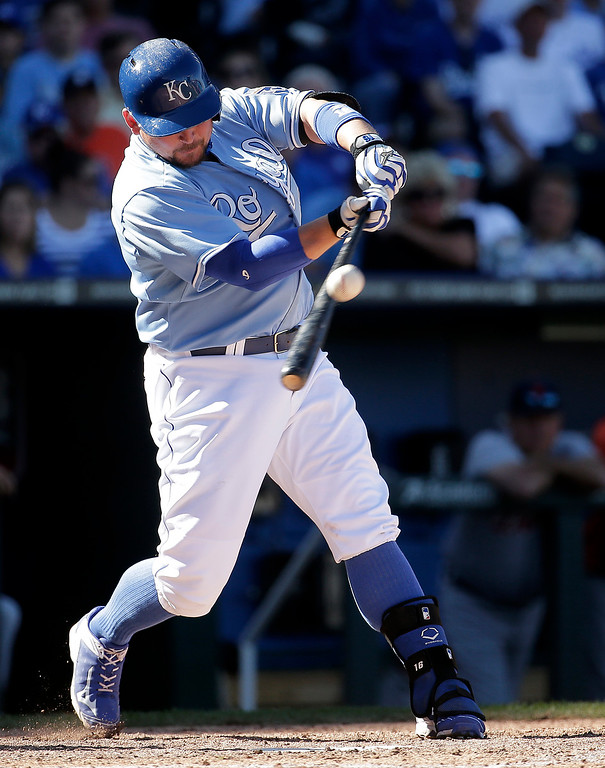 . Kansas City Royals\' Billy Butler hits a single during the seventh inning of a baseball game against the Detroit Tigers Sunday, Sept. 21, 2014, in Kansas City, Mo. (AP Photo/Charlie Riedel)