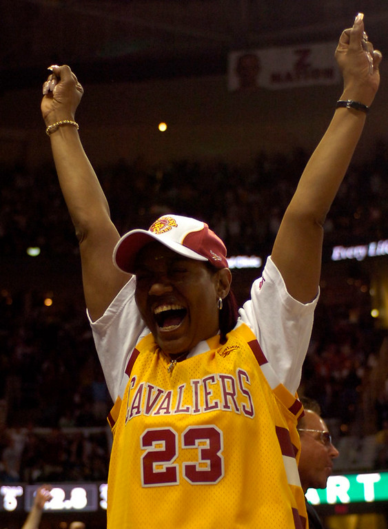 . PHOTO BY DAVID RICHARD Gloria James, the mother of Cleveland Cavalier LeBron James, cheers on her son in his first playoff game in the NBA. The 21-yearl-old didn\'t let her down as he recorded a triple-double - the first in Cavaliers\' playoff history.