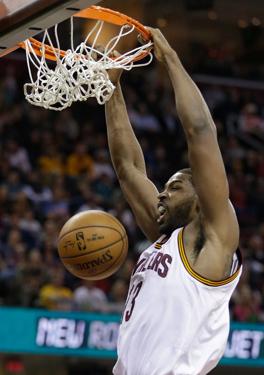 . Cleveland Cavaliers\' Tristan Thompson dunks against the Brooklyn Nets in the second half of an NBA basketball game, Friday, Dec. 23, 2016, in Cleveland. (AP Photo/Tony Dejak)