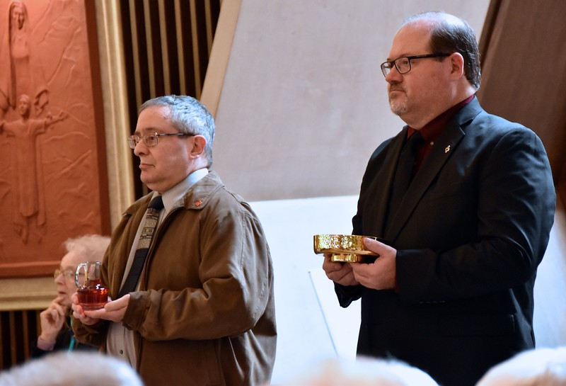 Br. Frank Presto and Br. Duane Lemke bring up the gifts