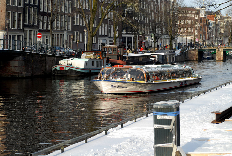 Canal boat in front of Anne Frank's house in Amsterdam.  All the streets were covered with snow and ice.