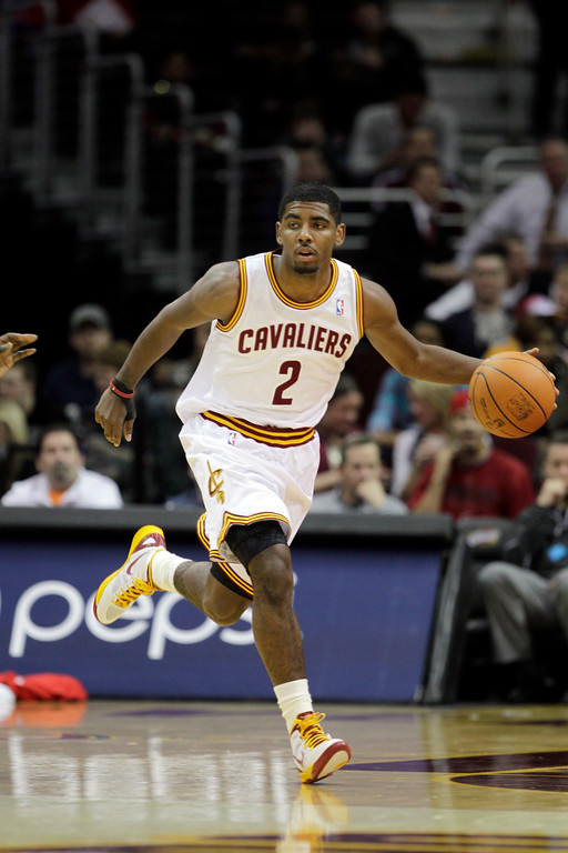 . Cleveland Cavaliers\' Kyrie Irving brings the ball up against the Detroit Pistons in a preseason NBA basketball game Tuesday, Dec. 20, 2011, in Cleveland. (AP Photo/Mark Duncan)