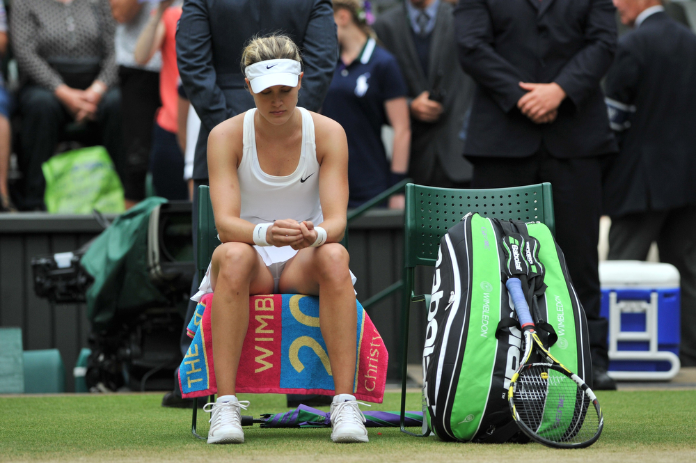 Description of . Runner up Canada's Eugenie Bouchard sits on her chair after losing to Czech Republic's Petra Kvitova the women's singles final match on day twelve of  the 2014 Wimbledon Championships at The All England Tennis Club in Wimbledon, southwest London, on July 5, 2014. (GLYN KIRK/AFP/Getty Images)