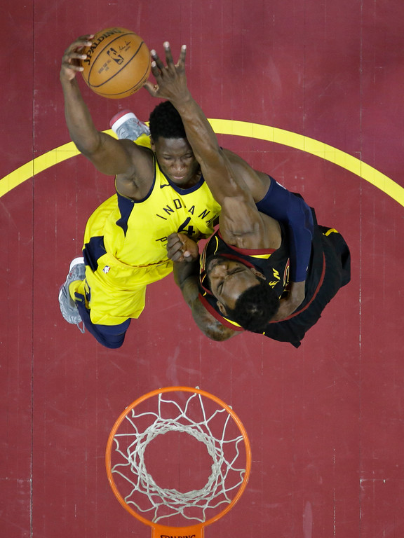 . Cleveland Cavaliers\' Jeff Green, right, blocks a shot by Indiana Pacers\' Victor Oladipo in the second half of Game 7 of an NBA basketball first-round playoff series, Sunday, April 29, 2018, in Cleveland. The Cavaliers won 105-101. (AP Photo/Tony Dejak)