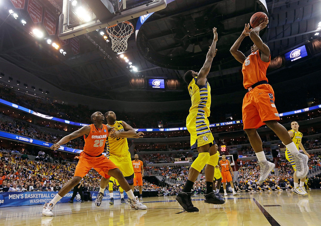 . Syracuse forward C.J. Fair (5) shoots over Marquette forward Jamil Wilson (0) during the second half of the East Regional final in the NCAA men\'s college basketball tournament, Saturday, March 30, 2013, in Washington. (AP Photo/Pablo Martinez Monsivais)