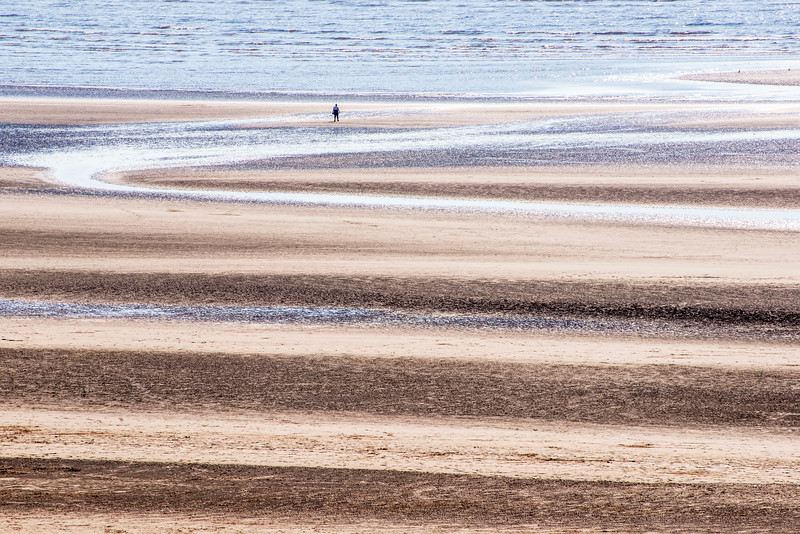 Captured this scene, of someone admiring the retreating Irish Sea, on the beach at Formby, England on 17/5/17.