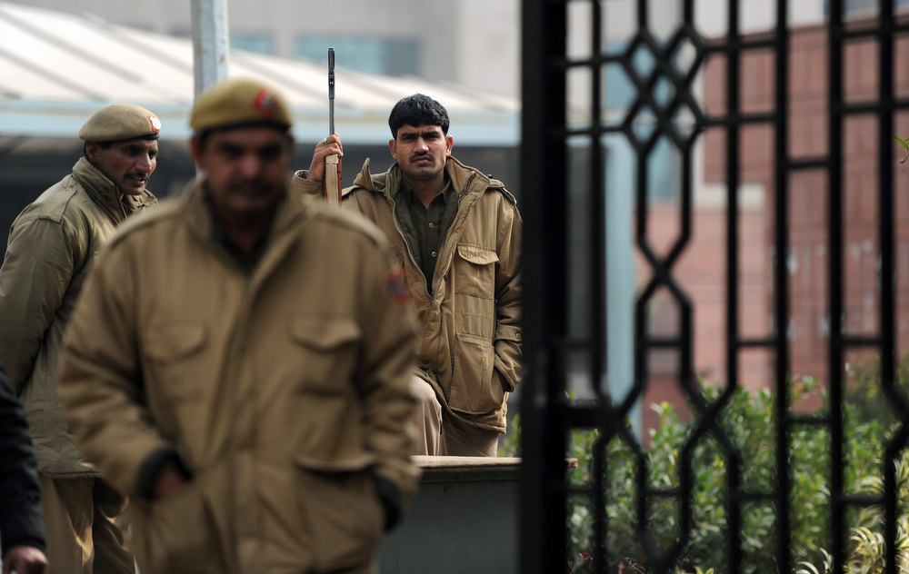 . Indian police personnel stand guard at an entrance to Saket District Court in New Delhi on January 3, 2013. A gang of men accused of repeatedly raping a 23-year-old student on a moving bus in New Delhi in a deadly crime that repulsed the nation are to appear in court for the first time. Police are to formally charge five suspects with rape, kidnapping and murder after the woman died at the weekend from the horrific injuries inflicted on her during an ordeal that has galvanised disgust over rising sex crimes in India. SAJJAD HUSSAIN/AFP/Getty Images