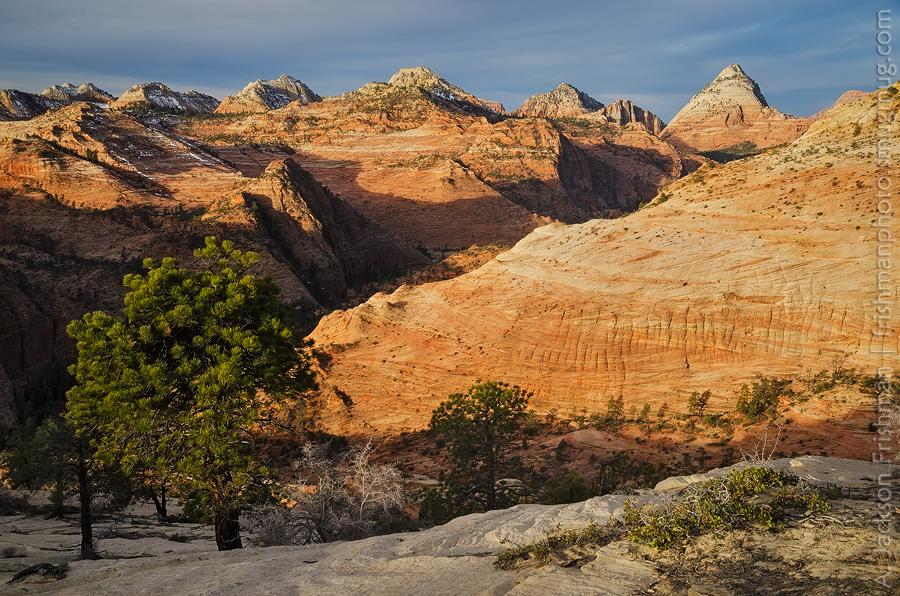 Sunrise on Bridge Mountain and the sandstone domes of the east entrance road, Zion National Park, Utah, March 2013.