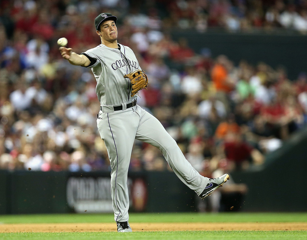. Infielder Nolan Arenado #28 of the Colorado Rockies fields a ground ball out against the Arizona Diamondbacks during the fifth inning of the MLB game at Chase Field on April 28, 2013 in Phoenix, Arizona.  (Photo by Christian Petersen/Getty Images)