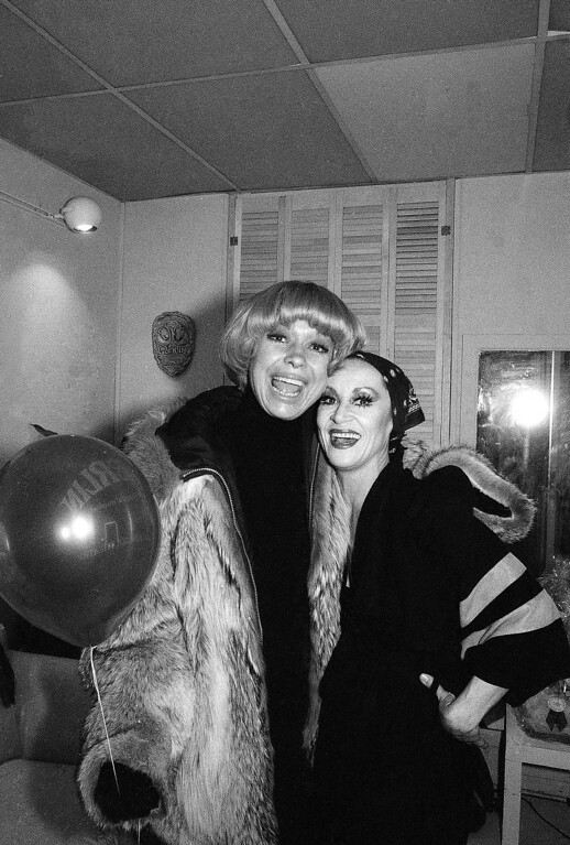 ". Actress Carol Channing, left, greets ""Merlin\"" cast member Chita Rivera backstage at New York?s Mark Hellinger Theater, Jan. 22, 1983, following a matinee performance of the new Broadway show. (AP Photo/Mario Cabrera)"