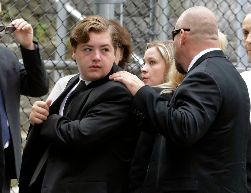 ". Michael Gandolfini, left, son of James Gandolfini, arrives for the funeral service of his father, star of ""The Sopranos,\"" in New York\'s the Cathedral Church of Saint John the Divine,  Thursday, June 27, 2013. (AP Photo/Richard Drew)"