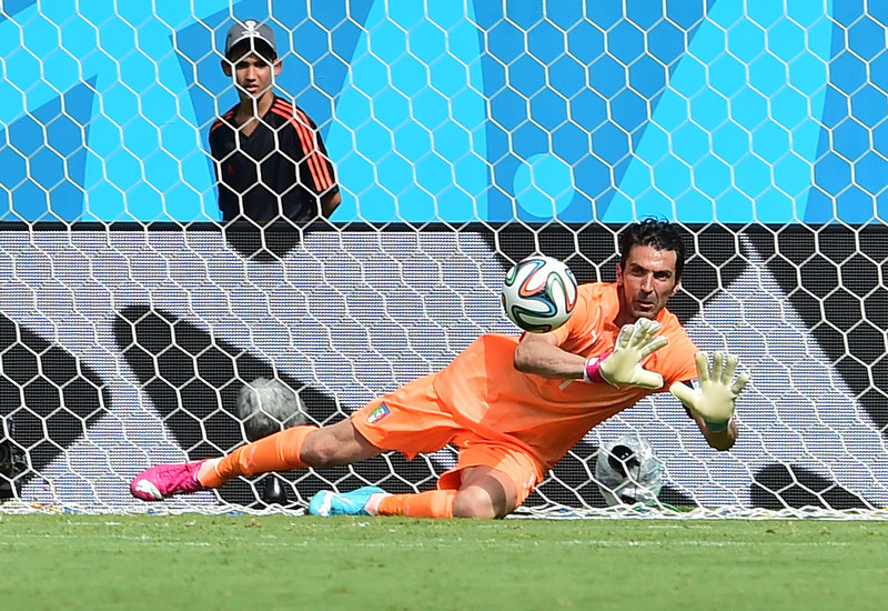 . Italy\'s goalkeeper Gianluigi Buffon dives for the ball during a Group D football match between Italy and Costa Rica at the Pernambuco Arena in Recife during the 2014 FIFA World Cup on June 20, 2014.  (GIUSEPPE CACACE/AFP/Getty Images)