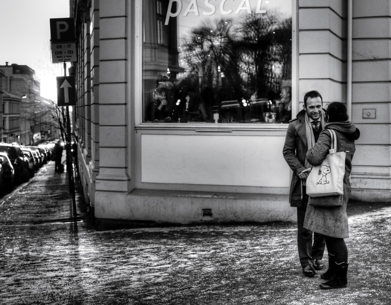 Couple outside a popular French bakery.