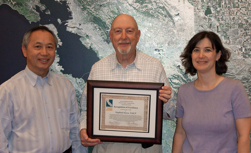 "This award was presented at the top of the awards program May 15th, but the certificate is being formally presented here by Hanson Hom, Director Elect, and Darcy Kremin, Section Director, to Naphtali Knox, in ""Recognition of Excellence for his ongoing outstanding contributions and tireless efforts as Editor of Northern News. Under his direction, Northern News has improved its quality and design exponentially, is extremely relevant, is 'green' in its distribution, presents interesting topics, and contains factual, objective and balanced articles on cutting-edge planning, urban design, and legislative issues."" July 1, 2009."