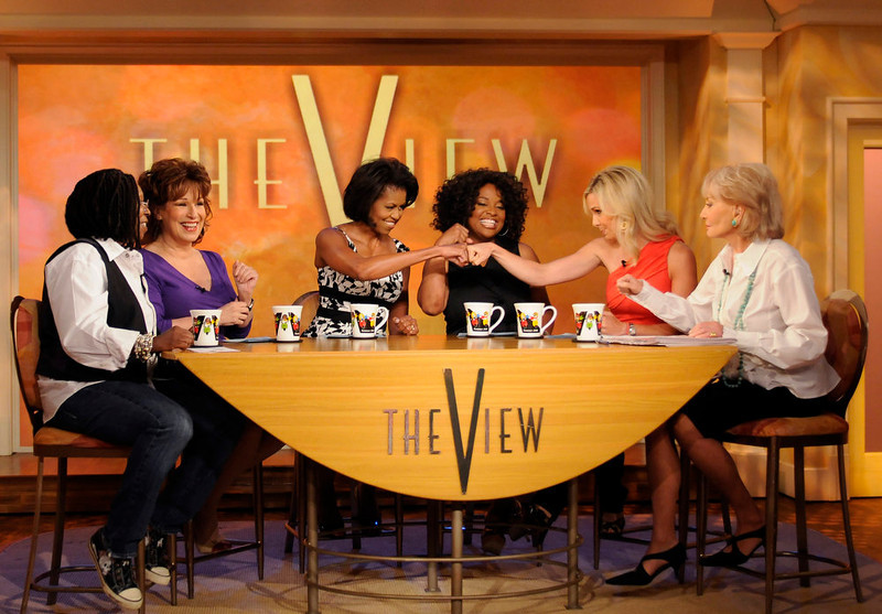 ". Michelle Obama, wife of Democratic presidential candidate Sen. Barack Obama, D-Ill., third from left, on the set of ""The View,\"" Wednesday, June 18, 2008 in New York. From left are, Whoopi Goldberg, Joy Behar, Mrs. Obama, Sherri Shepard, Elisabeth Hasselbeck, and Barbara Walters. (AP Photo/ABC, Steve Fenn)"