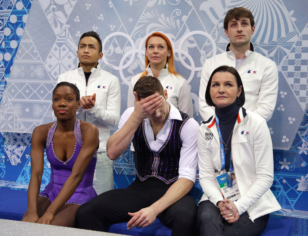 . Vanessa James and Morgan Cipres of France wait for their scores with teammates after competing in the Figure Skating Pairs Short Program during the Sochi 2014 Winter Olympics at Iceberg Skating Palace on February 6, 2014 in Sochi, Russia.  (Photo by Darren Cummings/Pool/Getty Images)