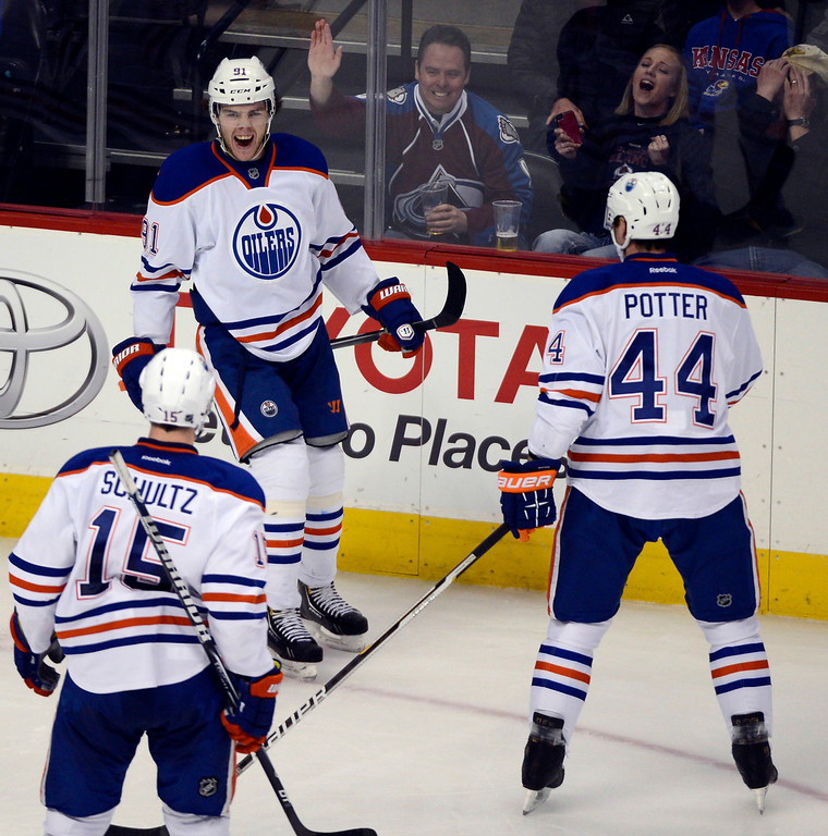 . Magnus Paajarvi (91) of the Edmonton Oilers celebrates his goal with Nick Schultz (15) of the Edmonton Oilers and Corey Potter (44) of the Edmonton Oilers during the second period March 12, 2013 at Pepsi Center. (Photo By John Leyba/The Denver Post)
