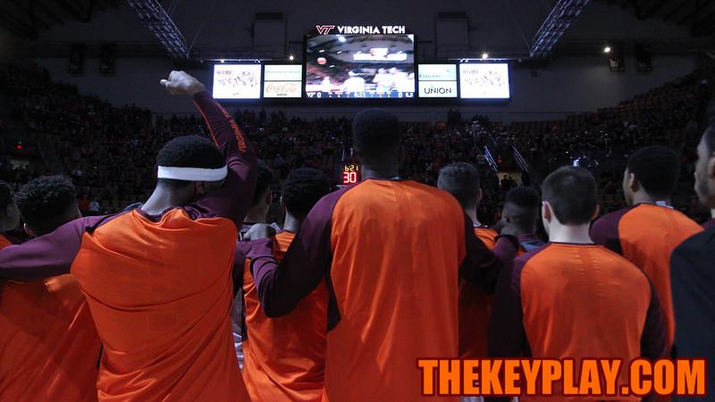 The Hokies watch a highlight reel of Shane Henry's career at Virginia Tech during the ceremony. (Mark Umansky/TheKeyPlay.com)