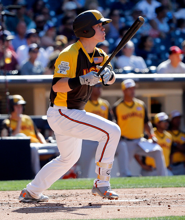 . U.S. Team\'s Chance Sisco, of the Baltimore Orioles, follows through during the second inning of the All-Star Futures baseball game, Sunday, July 10, 2016, in San Diego. (AP Photo/Lenny Ignelzi)