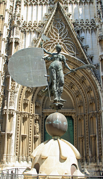 Cathedral entrance way with the original 16th century bronze weathervane (giraldillo) from the top of La Giralda portraying Faith.