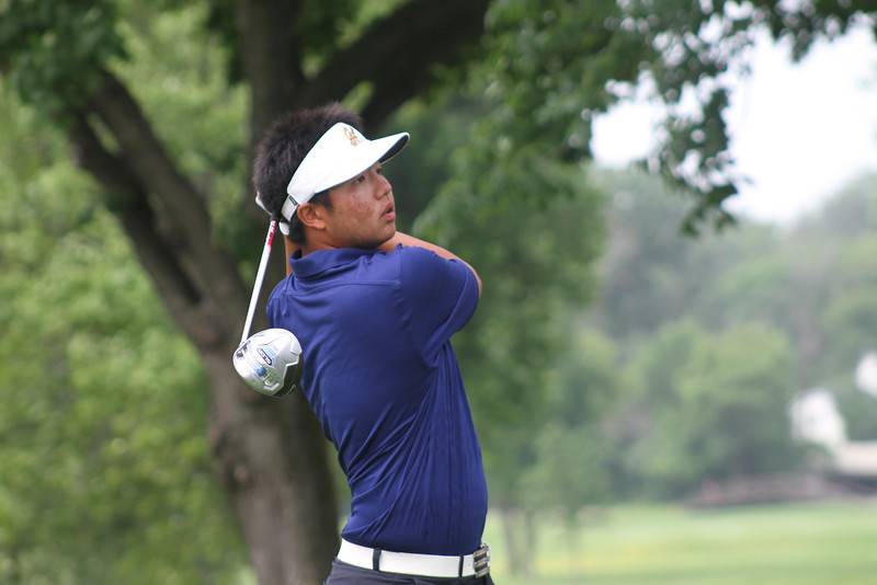 K.K. Limbhasut tees off during the third round of the 2014 Western Junior Championship.