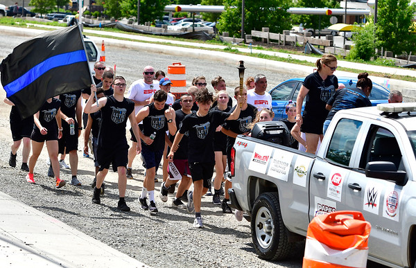6/6/2019 Mike Orazzi | Staff The Bristol Police section of the annual Law Enforcement Torch Run along Route 6 in Bristol Thursday afternoon.