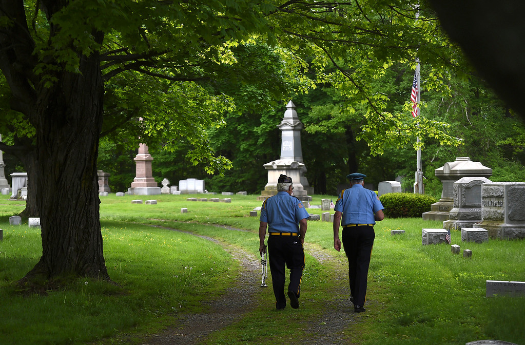 . Kayla Rice/Reformer Members of the American Legion Post 5 band walk in to the Prospect Hill cemetery before the Memorial Day Service there on Monday morning.