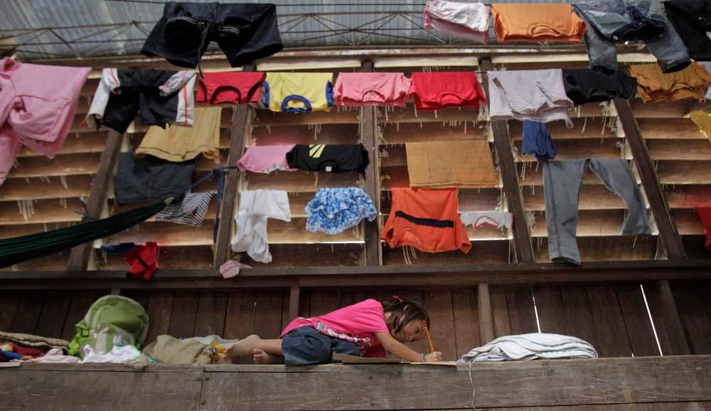 . A girl studies at a gymnasium turned into an evacuation centre for residents who were rendered homeless after their houses were swept by floodwaters at the height of Typhoon Bopha, in New Bataan town, in Compostela Valley, southern Philippines December 8, 2012. Philippine President Benigno Aquino declared a state of national calamity on Saturday, four days after this year\'s strongest typhoon left nearly 1,000 people dead or missing mostly in the country\'s resource-rich south. REUTERS/Erik De Castro