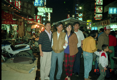 Exploring Taipei's Snake Alley at nighttime.  Henry Fan and wife, and...?