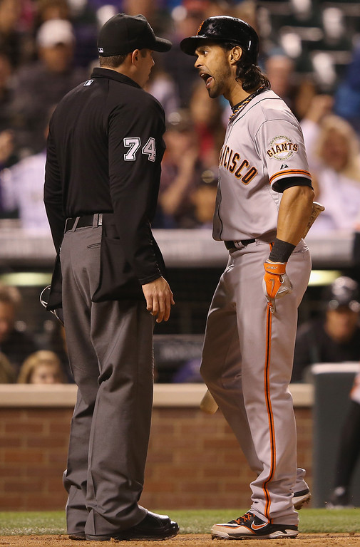 . Umpire John Tumpane ejects Angel Pagan #16 of the San Francisco Giants from the game for arguing balls and strikes after being called out on strikes against Tommy Kahnle #54 of the Colorado Rockies in the seventh inning at Coors Field on April 21, 2014 in Denver, Colorado.  (Photo by Doug Pensinger/Getty Images)