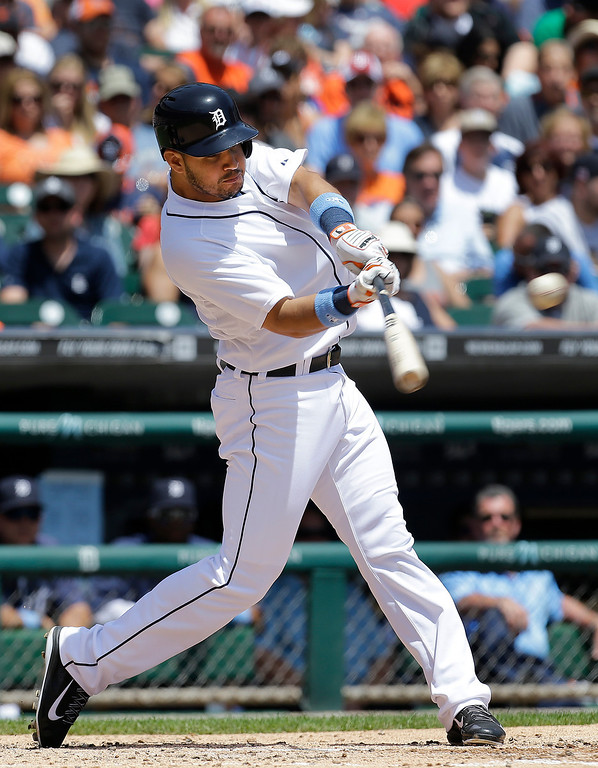 . Detroit Tigers\' Eugenio Suarez singles against the Minnesota Twins in the second inning of a baseball game in Detroit, Sunday, June 15, 2014. (AP Photo/Paul Sancya)