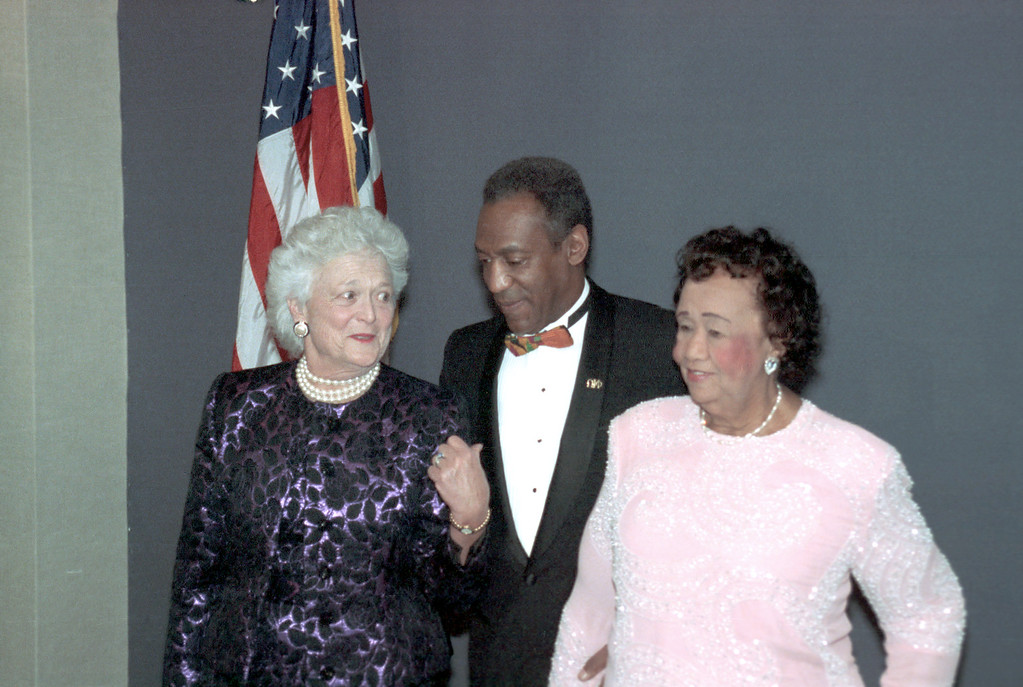 . First lady Barbara Bush, left, joins comedian Bill Cosby, center, to honor Dr. Dorothy Height, president of the National Council of Negro Women, for her work in the black community at the New York Hilton, March 12, 1991.  (AP Photo/Mario Cabrera)