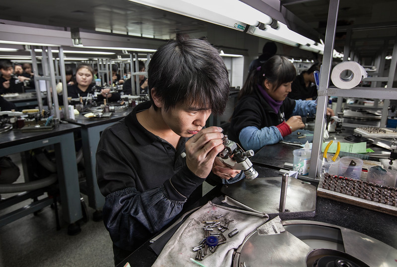 Workers polish diamonds in one of two rooms of polishing benches at the Guangzhou Mickey Weinstock & Co Diamonds Manufacturing Limited diamond polishing factory in Shawan, Panyu District, Guangzhou, Guangdong Province, China on Monday, Jan. 24, 2011.