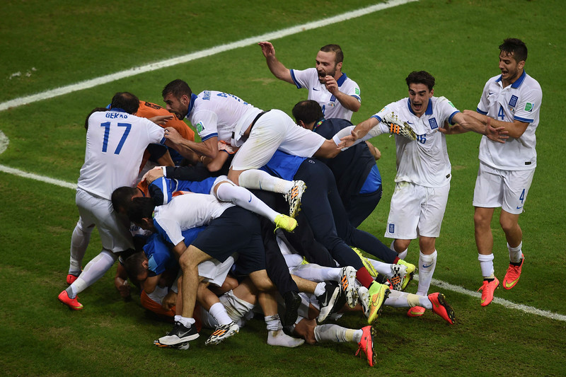 . Greece\'s players celebrate after their victory during a Group C football match between Greece and Ivory Coast at the Castelao Stadium in Fortaleza during the 2014 FIFA World Cup on June 24, 2014. (CHRISTOPHE SIMON/AFP/Getty Images)