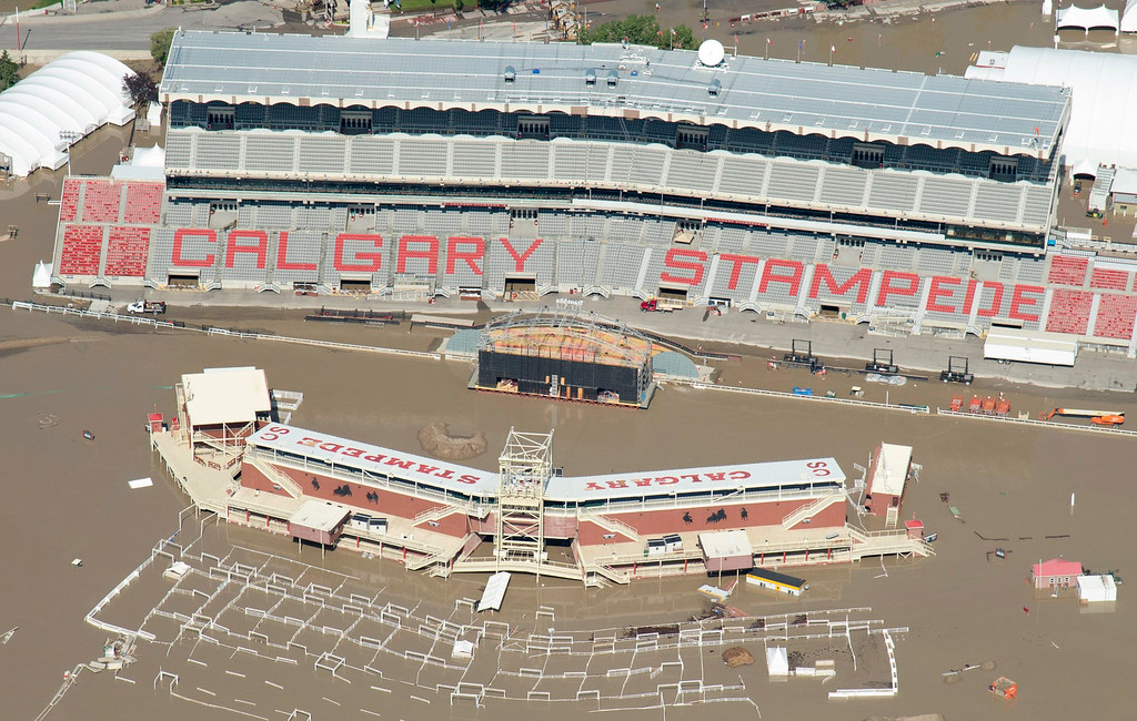 . This aerial photo shows a flooded Calgary Stampede stadium in Calgary, Alberta, Canada flooded on Saturday, June 22, 2013. (AP Photo/The Canadian Press, Jonathan Hayward)