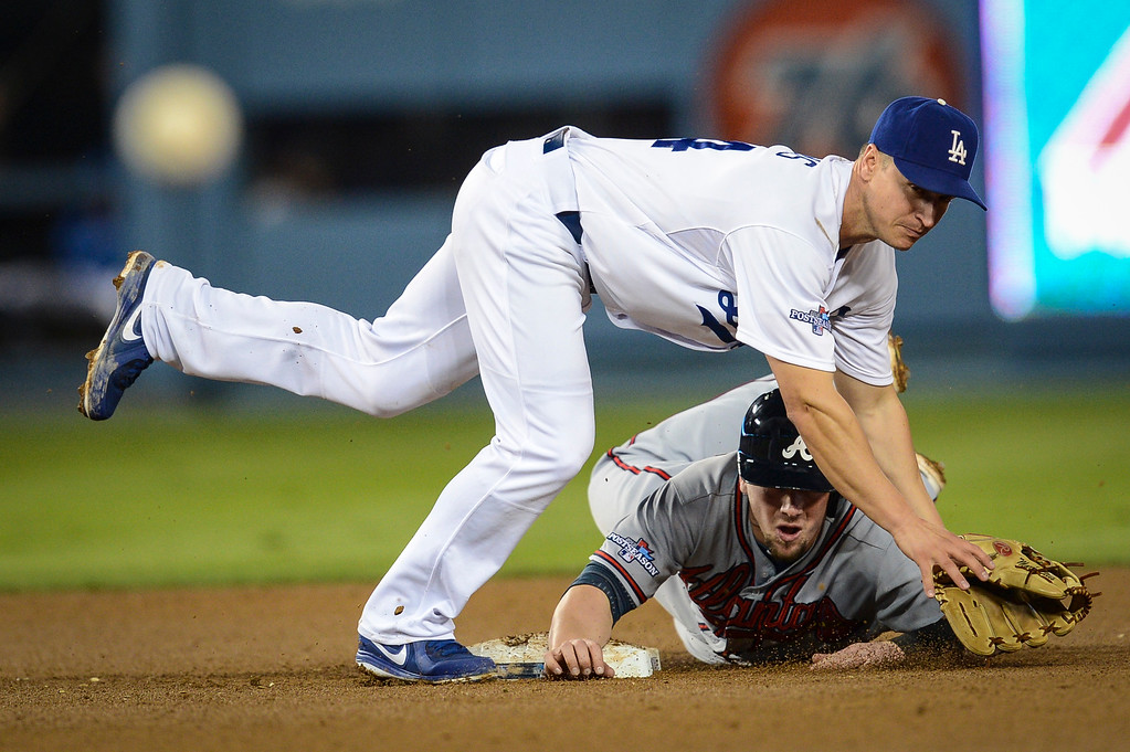 . Dodgers Mark Ellis throws for a DP as Atlanta\'s Chris Johnson is out at second during game 4 action Monday, October 7, 2013 ( Photo by Hans Gutknecht/Los Angeles Daily News )