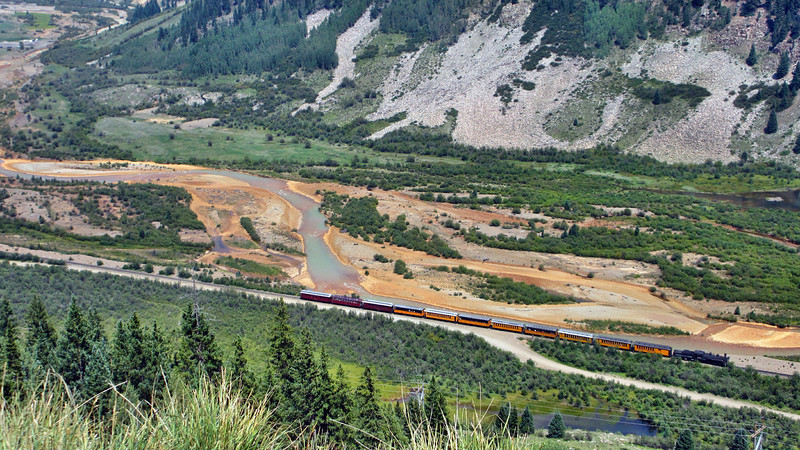 Driving over 11,018 feet Red Mountain Pass on the Million Dollar Highway US550 between Grand Junction, CO, to Durango, CO - the D&RNG train departing Silverton, CO