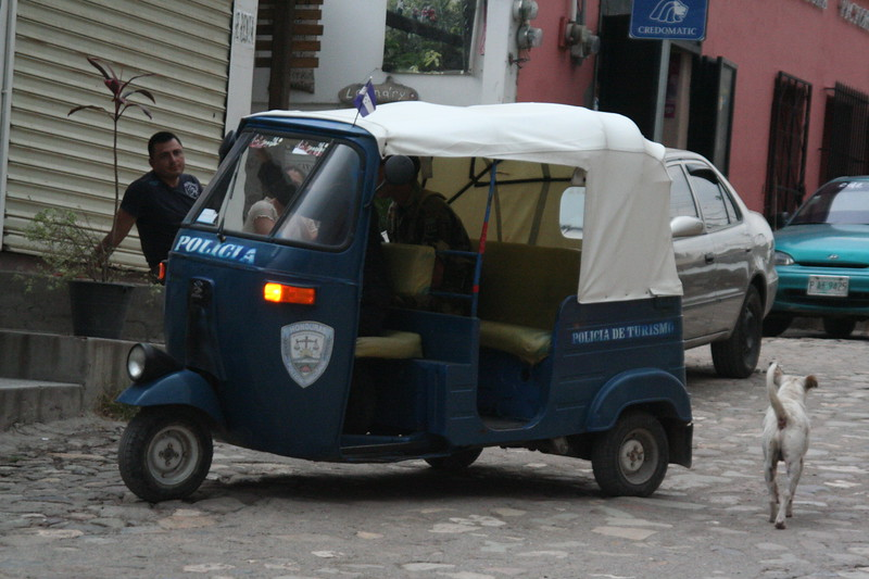 You know it's a tourist town when even the police ride a tuk-tuk